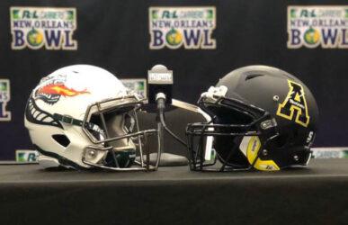 Both Team Helmets courtesy of each Head Coach